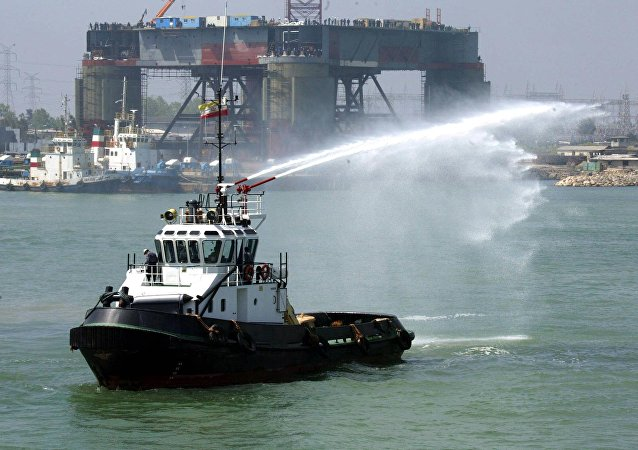 A barge sprays water during the opening of the Neka oil terminal on the Caspian Sea, 340 kms northwest of Tehran in Mazandaran province (file)