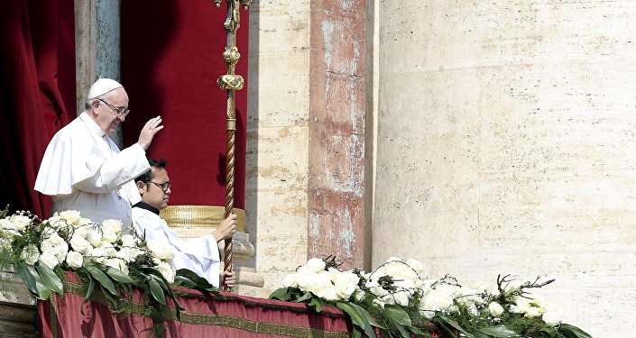 Pope Francis delivers the Urbi et Orbi benediction at the end of the Easter Mass in Saint Peter's Square at the Vatican