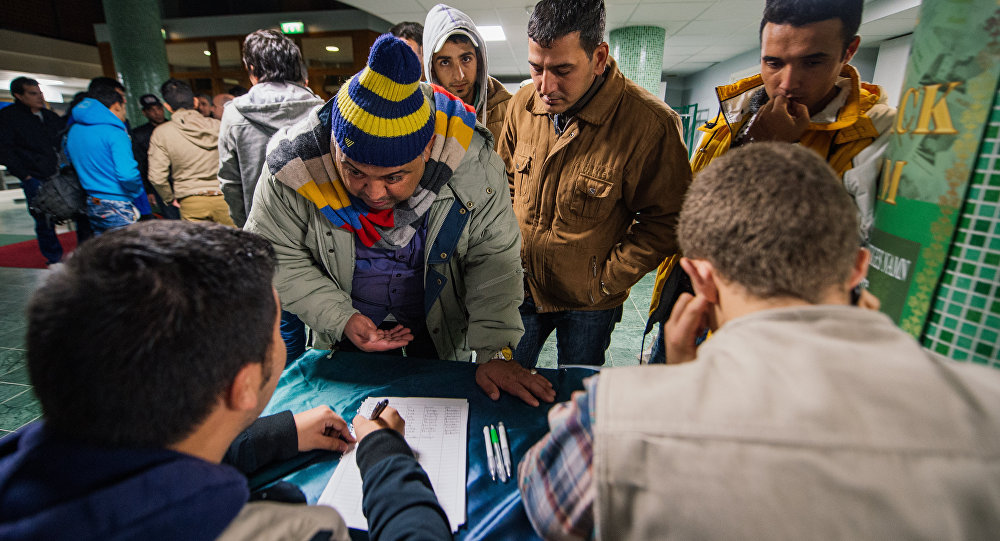 Refugee's register their names as they arrive to Stockholm central mosque on October 15, 2015 after many hours bus journey from the southern city of Malmo.