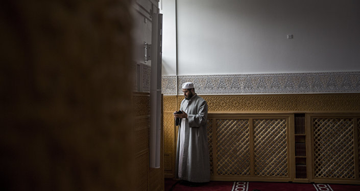A man during the official opening of Denmark's first mosque with a dome and minaret in Rovsingsgade, Copenhagen