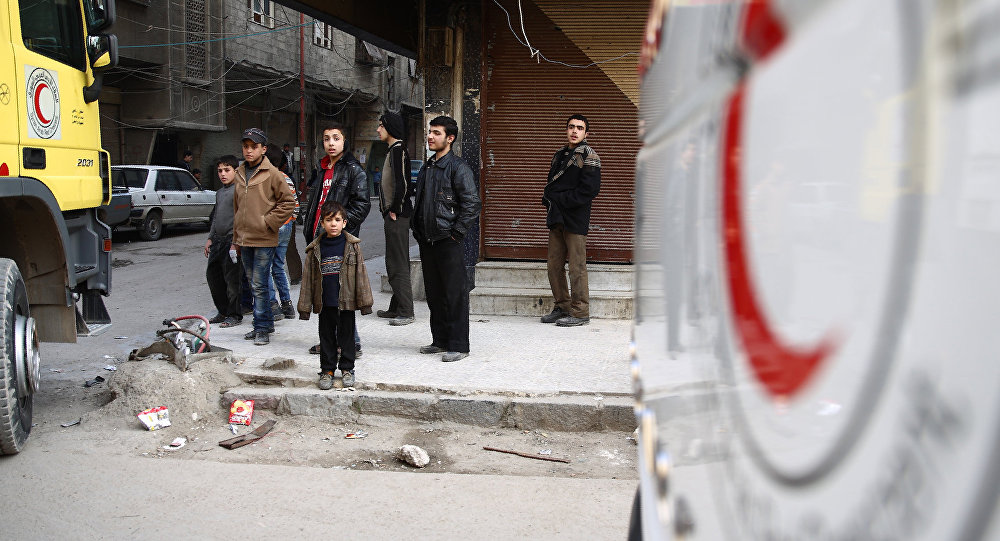A convoy of the Syrian Red Crescent entered the Douma area bringing medicines and also milk for children (File)