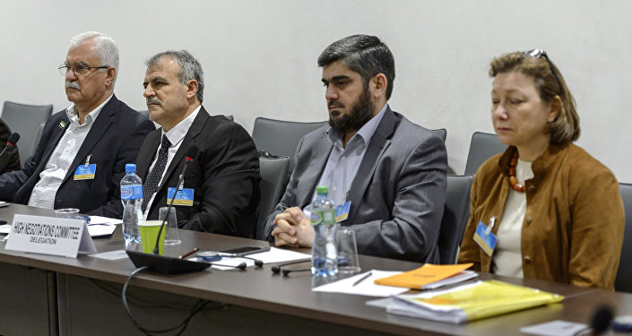 (From L) George Sabra and Asaad Al-Zoubi, of the delegation of the High Negotiations Committee (HNC), Mohamed Alloush of the Jaysh al Islam and Bassma Kodmani of the delegation of the HNC take part in a round of negotiations between representatives of the Internal Damascus Platform and United Nations on March 23, 2016