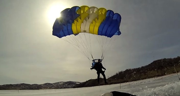 Skydivers Plunge from 1,200m into Icy Lake Baikal
