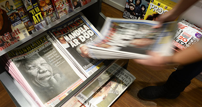 Swedish newspapers with frontpages depicting South Africa's anti-apartheid icon Nelson Mandela