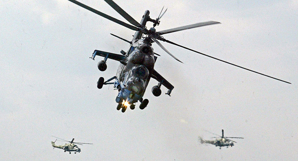 Mi-24 helicopter gunships of Berkuty (Golden Eagles) Russian aerobatic team perform during the Flying Legend.