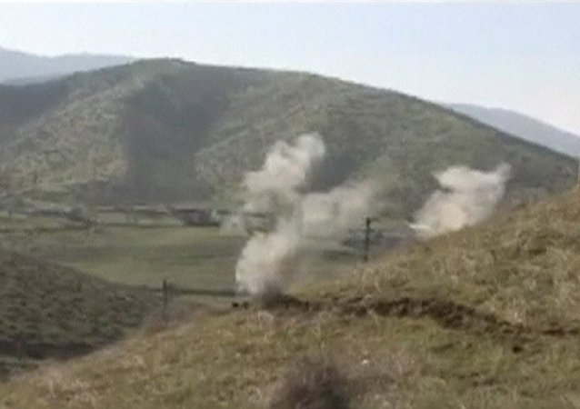 Smoke rises after clashes between Armenian and Azeri forces in Nagorno-Karabakh region in this still image taken from video provided by the Nagorno-Karabakh region Defence Ministry April 2, 2016.