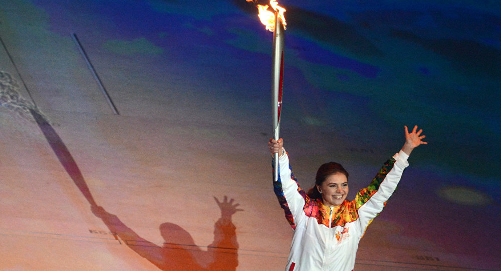 Torch-bearer, State Duma deputy Alina Kabayeva takes part in the final stage of the Olympic Torch Relay at the opening ceremony of the XXII Olympic Winter Games in Sochi. (File)