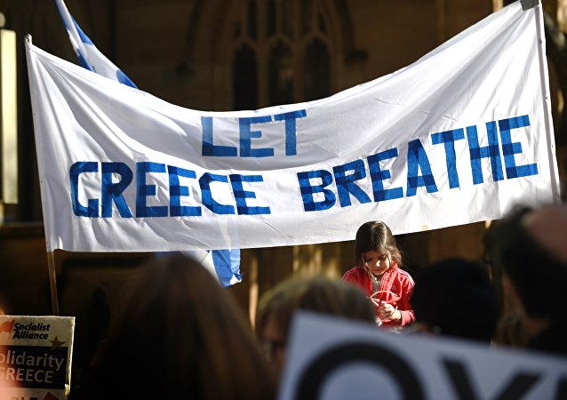 A young girl reacts as she joins Greek residents and other supporters at a rally in Sydney on July 4, 2015.