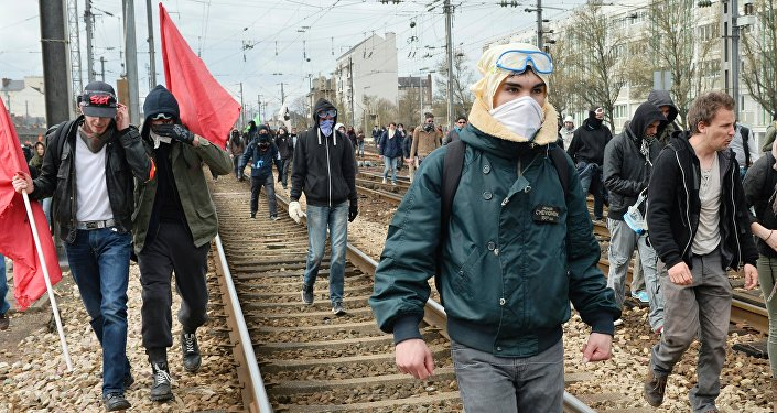 Protesters invade railway tracks during a protest against the French government's planned labour law reforms on April 5, 2016, in Rennes, western France.