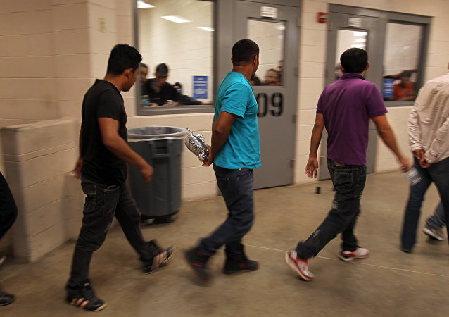 Immigrants who have been caught crossing the border illegally are housed inside the McAllen Border Patrol Station in McAllen, Texas, where they are processed on July 15, 2014