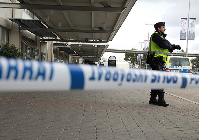 A police officer guard the cornered off domestic flight terminal at Goteborg Landvetter airport after a bomb threat on March 31, 2016