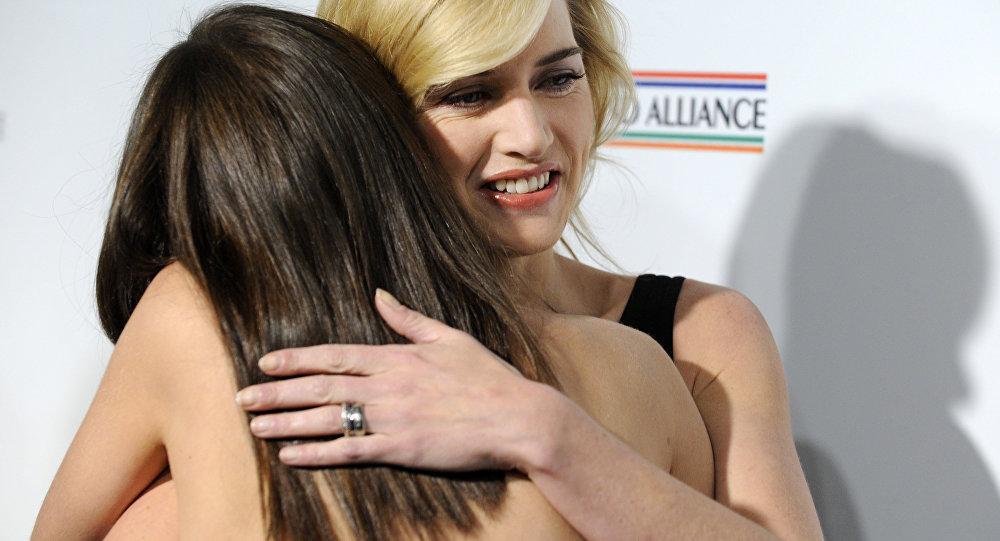 British actress Kate Winslet gets a hug from fellow actress Marion Cotillard.
