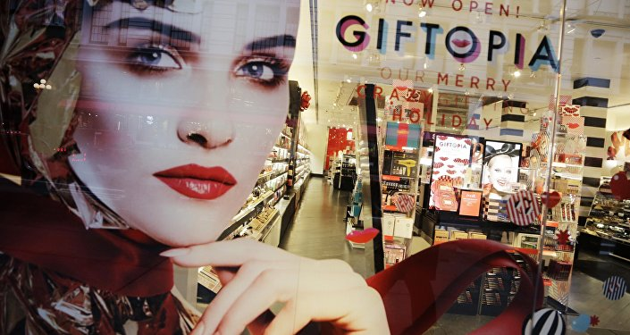 Holiday gift giving ideas are featured in a Sephora window.