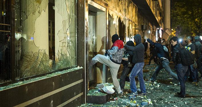 Protesters ransack the public office of President Gjorge Ivanov in Skopje on April 13, 2016