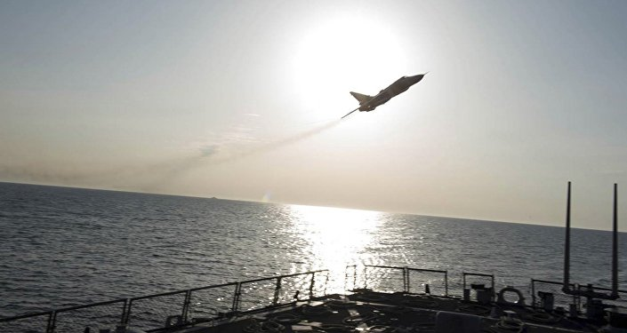An US Navy picture shows what appears to be a Russian Sukhoi Su-24 attack aircraft flying over the US guided missile destroyer USS Donald Cook in the Baltic Sea in this picture taken April 12, 2016 and released April 13, 2016