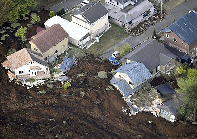 The aftermath of a landslide and destroyed houses caused by an earthquake are seen in Minamiaso town, Kumamoto prefecture, southern Japan, in this photo taken by Kyodo April 16, 2016