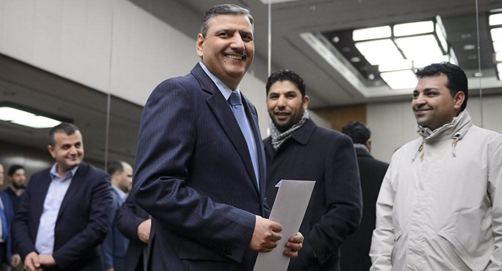 Syrian opposition chief Riad Hijab (C) arrives to a press conference after Syrian peace talks  in Geneva (File)