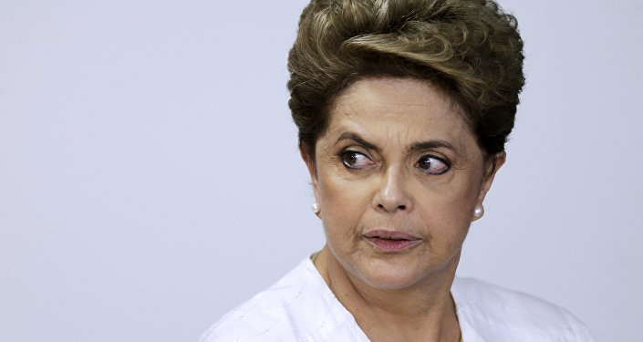 Dilma Rousseff looks on during signing of federal land transfer agreement for the government of the state of Amapa at Planalto Palace in Brasilia, Brazil, April 15, 2016