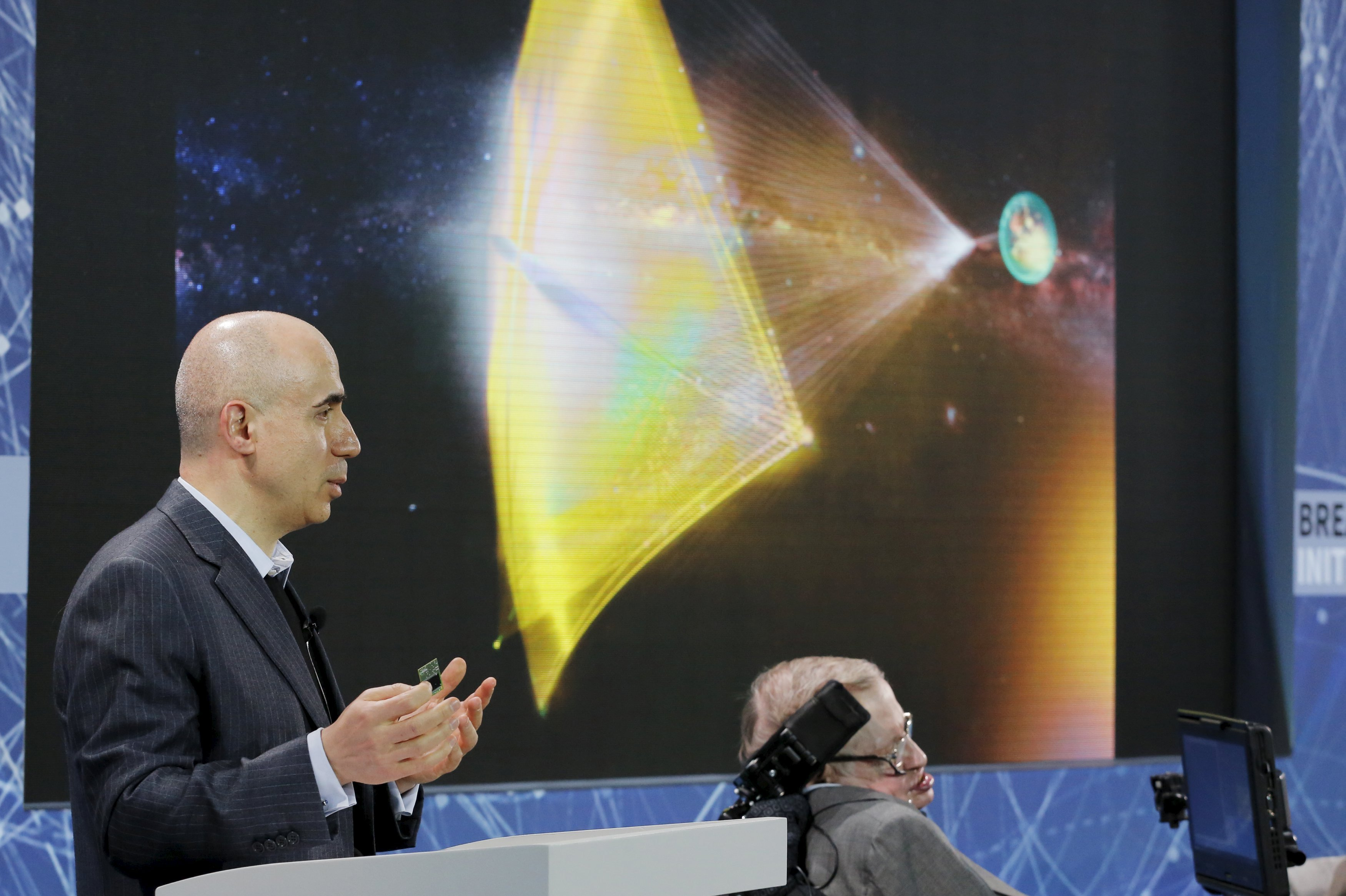 Investor Yuri Milner holds a small chip during an announcement of the Breakthrough Starshot initiative with physicist Stephen Hawking in New York April 12, 2016