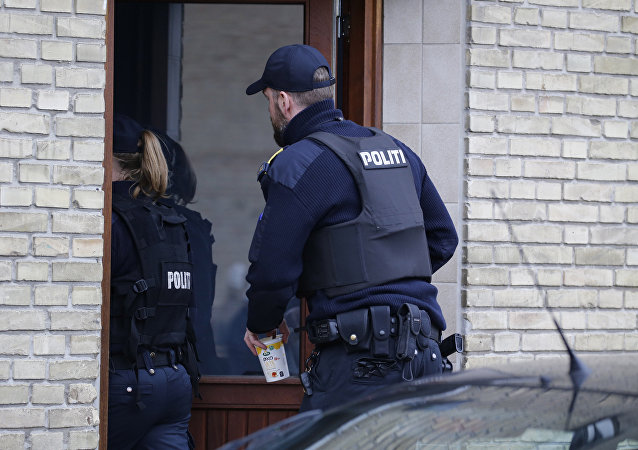 Danish Police search an apartment in Tingbjerg, Copenhagen, Denmark, Thursday, April 7, 2016.
