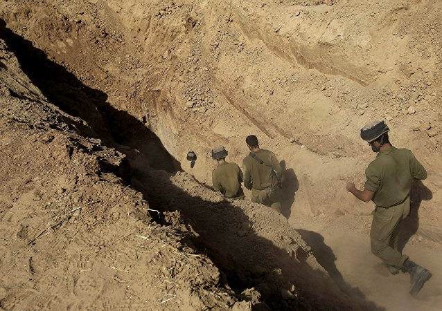 Israeli soldiers enter a tunnel discovered near the Israel Gaza border (File)
