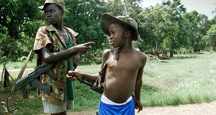 Two children enrolled with Sierra Leonean troops fighting rebels of the Revolutionary United Front (RUF).