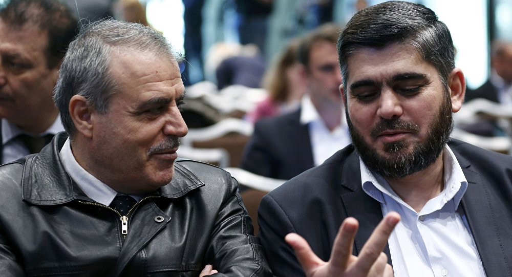 Members of the High Negotiations Committee (HNC) Asaad Al-Zoubi (L) and Mohamed Alloush of the Jaysh al Islam talk before a news conference aside of Syria peace talks in Geneva, Switzerland, April 19, 2016.