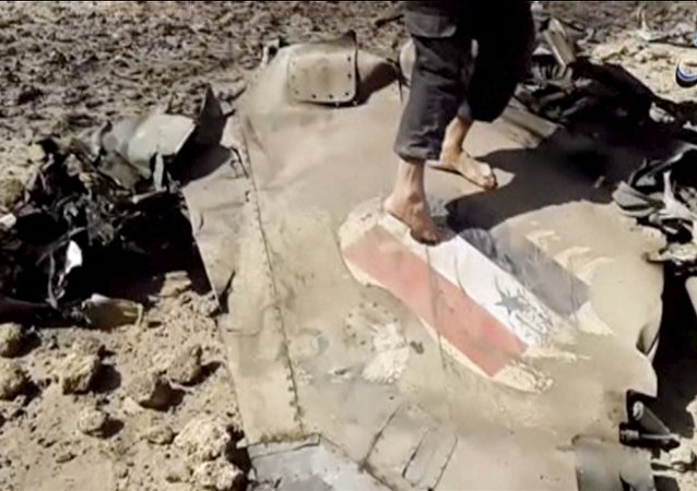 A man walks on the wreckage of a plane that crashed southeast of Damascus, Syria in this still image taken from video said to be shot April 22, 2016