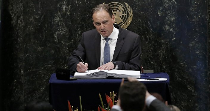 Australian Minister of Environment Greg Hunt signs the Paris Agreement on climate change held at the United Nations Headquarters in Manhattan, New York, U.S., April 22, 2016