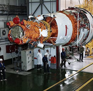Rocket-and-space industry experts prepare the Resurs-P No. 3 remote-sensing Earth surface observation satellite for launch at Baikonur Cosmodrome. File photo