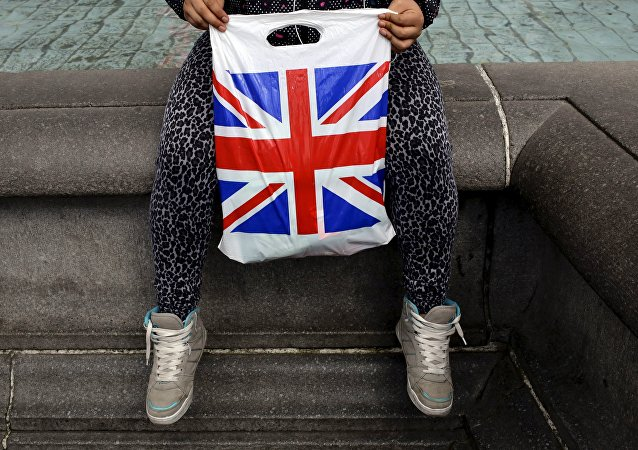 A woman holds a Union Flag shopping bag in London, Britain April 23, 2016