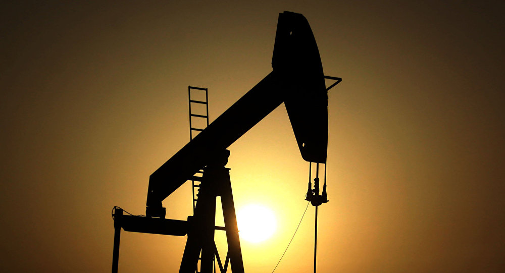 In this Wednesday, June 8, 2011 file photo, sun sets behind an oil pump