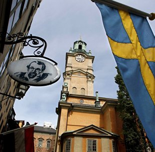 Sweden's flag is seen near the Stockholm Cathedral in Gamla Stan or the Old Town district of Stockholm, Sweden