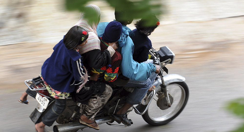 A family of five ride on a motorcycle in India. (File)