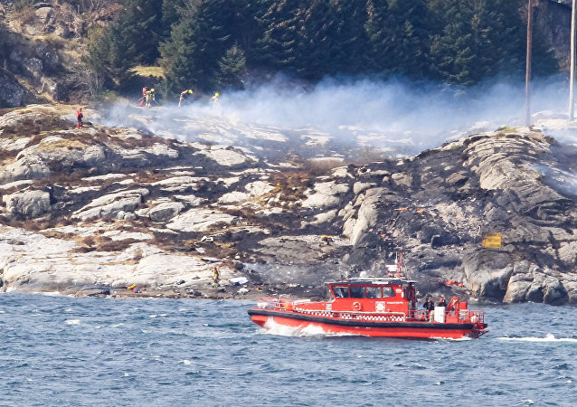 Rescuers work at a site where a helicopter has crashed, west of the Norwegian city of Bergen April 29, 2016.