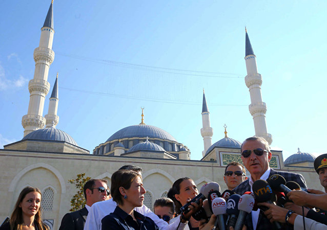 Turkish President Recep Tayyip Erdogan speaks to the media after Eid Al-Fitr prayers in Istanbul.
