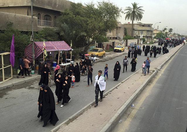 Shiite pilgrims march toward the Imam Mousa al-Kadhim shrine to commemorate the anniversary of the Imam's death in Baghdad, Iraq, Friday, April 29, 2016