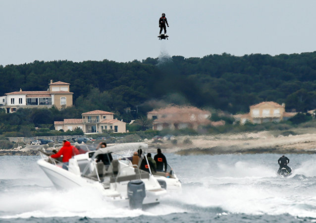 Jet ski champion Franky Zapata hovers in the air on an IPU Flyboard Air hoverboard as he breaks the Guiness World Records for furthest flight by hoverboard