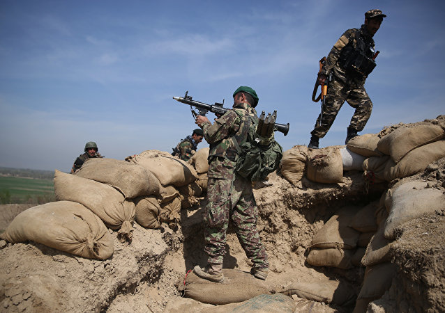 An Afghan National Army soldier, center, takes his position, following weeks of heavy clashes to recapture the area from Taliban militants in Dand-e Ghouri district in Baghlan province, north of Kabul, Afghanistan (File)