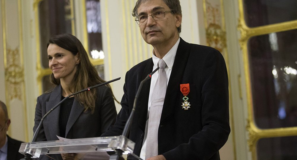 Orhan Pamuk, Turkish novelist and a Nobel Laureate, speaks after he was awarded the medal of Commander of Arts and Letters.