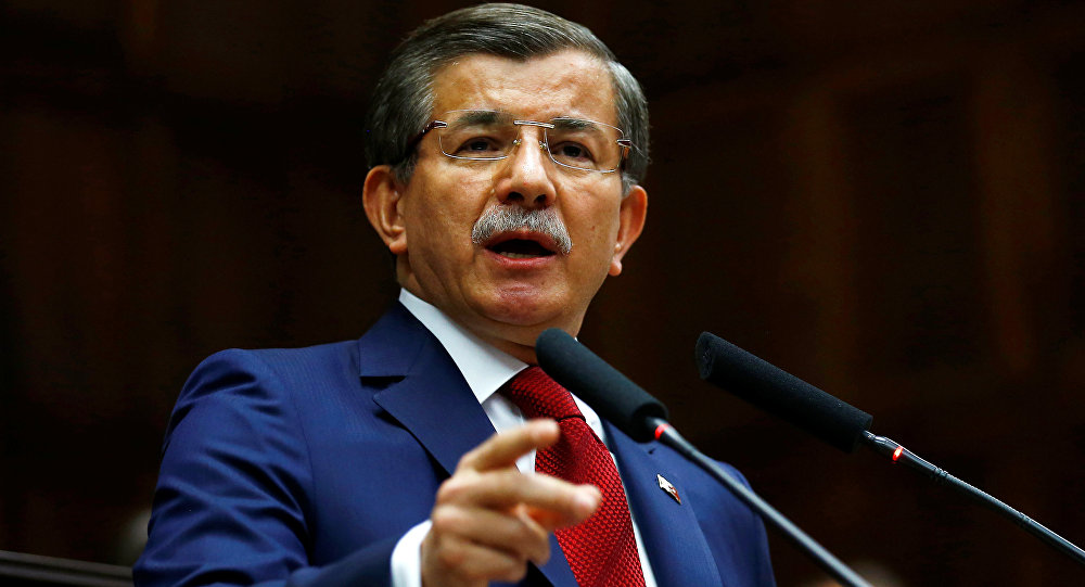 Turkey's Prime Minister Ahmet Davutoglu addresses members of parliament from his ruling AK Party (AKP) during a meeting at the Turkish parliament in Ankara, Turkey, May 3, 2016.