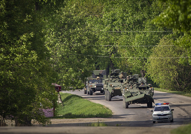 US military vehicles drive on a road in Sculeni, Moldova, Tuesday, May 3, 2016
