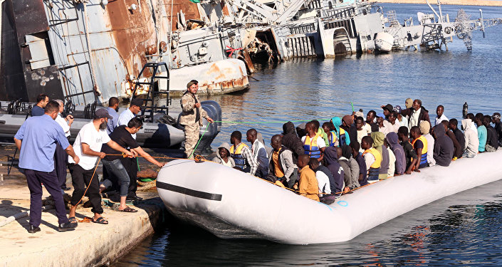 The Libyan coastguard pull a boat carrying illegal African migrants, rescued as they were trying to reach Europe, at a naval base near the capital Tripoli on September 29, 2015.