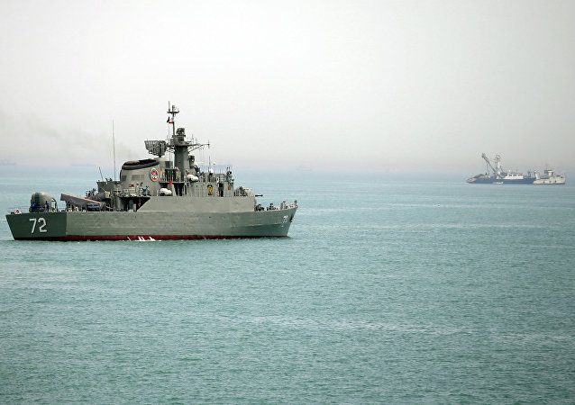 In this picture taken on Tuesday, April 7, 2015, and released by the semi-official Fars News Agency, Iranian warship Alborz, foreground, prepares before leaving Iran's waters, at the Strait of Hormuz