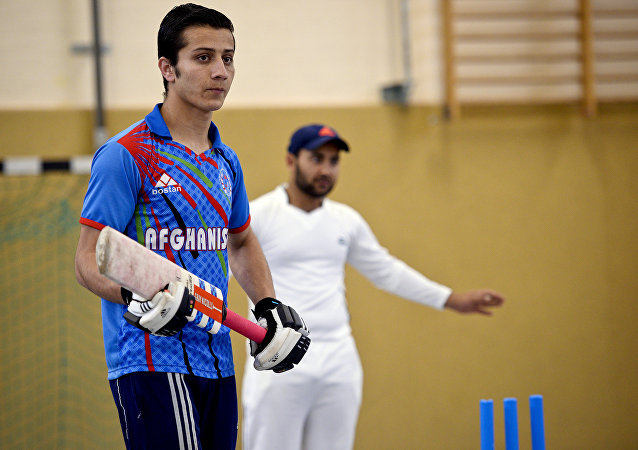 Afghan refugees take part in a Cricket training session at the team of the Altendorf 09 Blue Tigers in Essen, western Germany, on April 30, 2016.