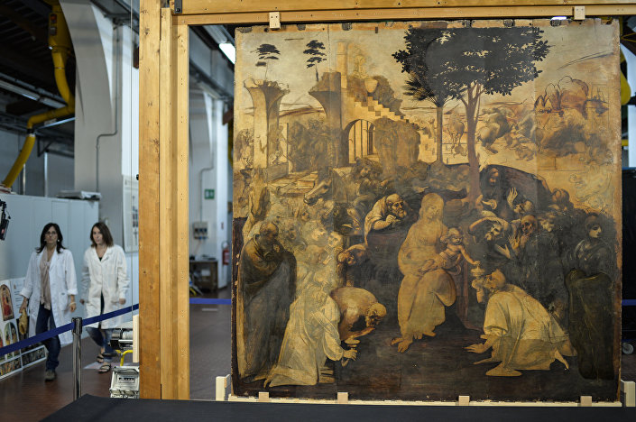 Restorers walk past the painting Adoration of the Magi (Adorazione dei Magi) representing a nativity scene by Italian Renaissance master Leonardo da Vinci, during its restoration in the Opificio delle Pietre Dure restoration laboratories at Fortezza da Basso, in Florence, on September 23, 2014.