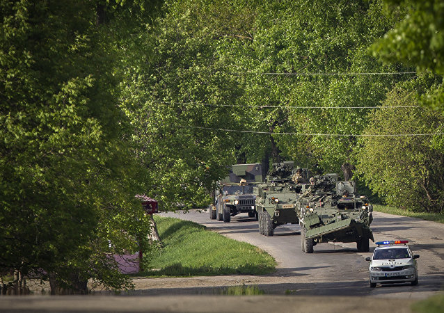 US military vehicles drive on a road in Sculeni, Moldova, Tuesday, May 3, 2016,