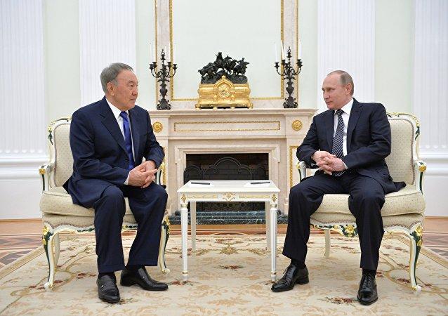 Russian President Vladimir Putin meets with Kazakh President Nursultan Nazarbayev