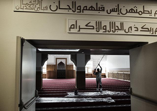 A worker paints a wall inside the mosque in Rovsingsgade in Copenhagen on June 16, 2014