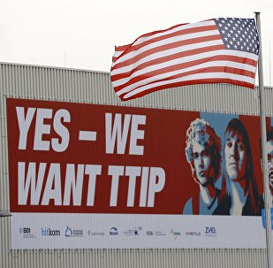 The flag of the USA flutters over a hall of the Hanover Fair decorated with a banner supporting the free trade agreement TTIP (Transatlantic Trade and Investment Partnership) in Hanover, Germany April 25, 2016